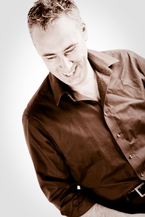 Sepia Toned Headshot of Simon Raybould, before he used Laura Pearman Photography Headshot Services