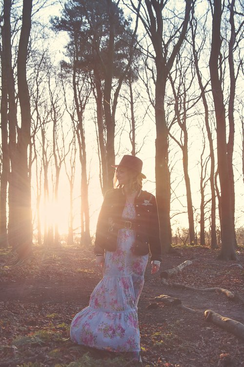 Ceryn Rowntree at Sunrise walking through the woods at Northumberlandia