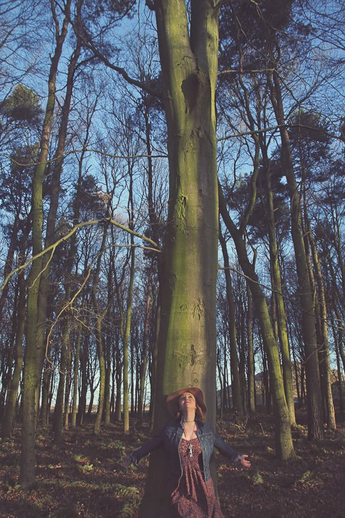 Ceryn in amongst the tall woodland trees in the woods at Northumberlandia