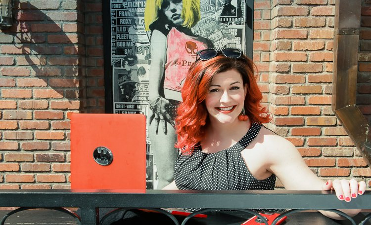 A Batman Logo encrusted laptop moment of christine at gaslmap district in San Diego for her headshots with Laura Pearman Photography
