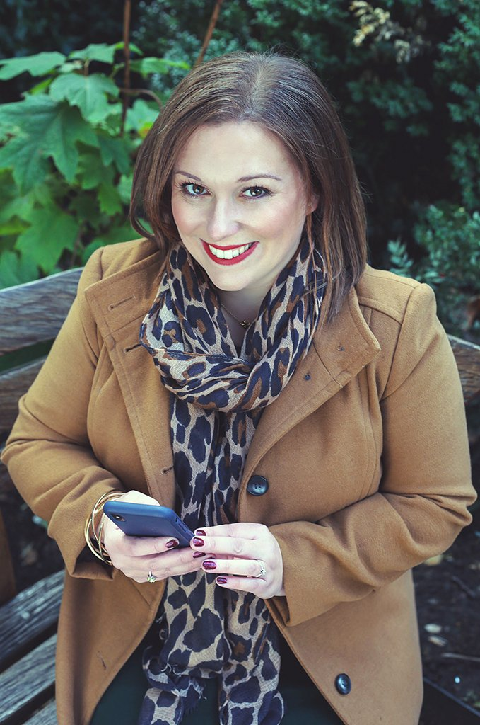Rachel Miller handling internal communications on her mobile phone whilst at her headshots session